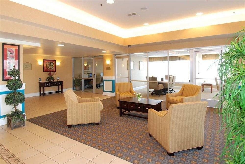Reception and lobby at GHMG Hotel