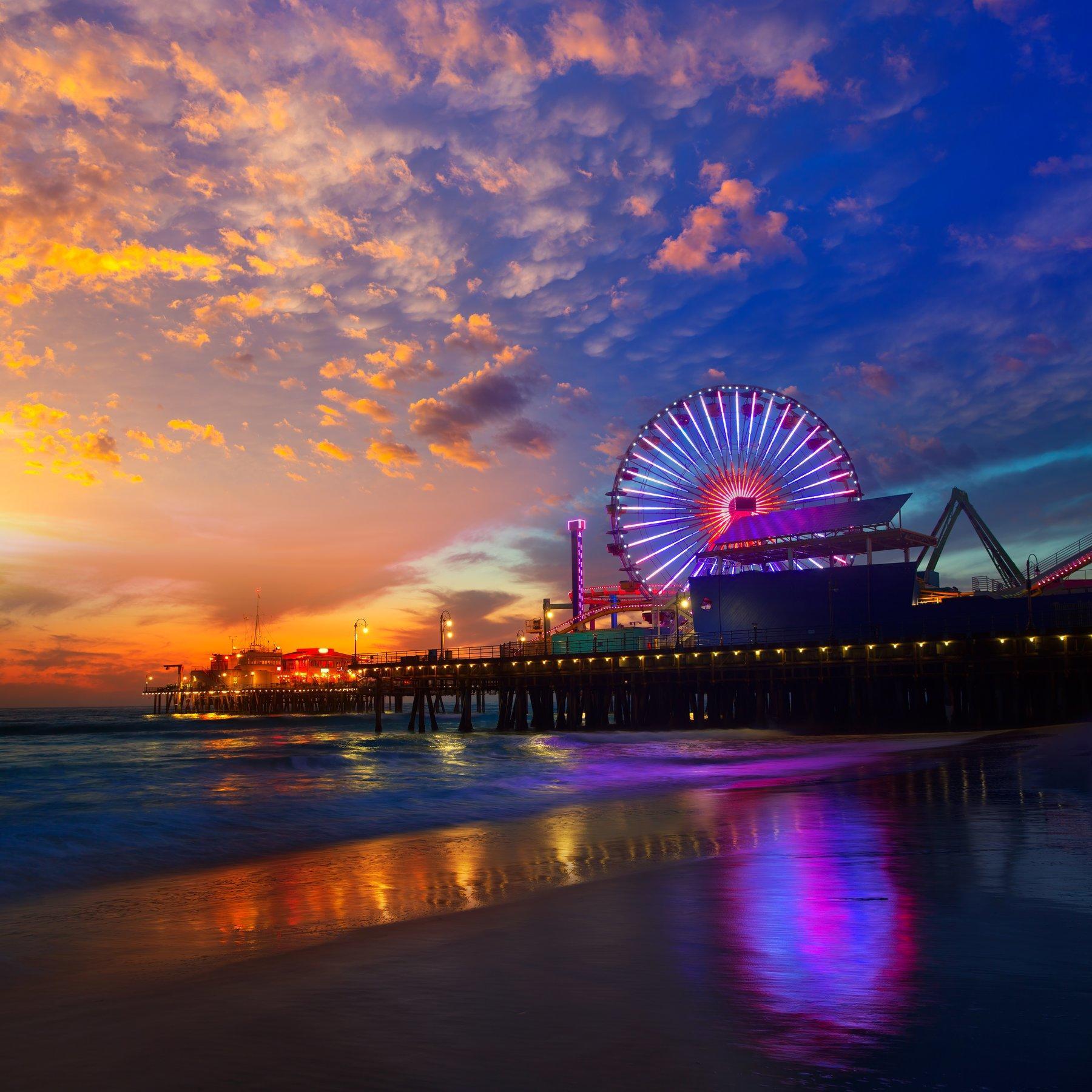 Santa Monica Pier lit up at sunset