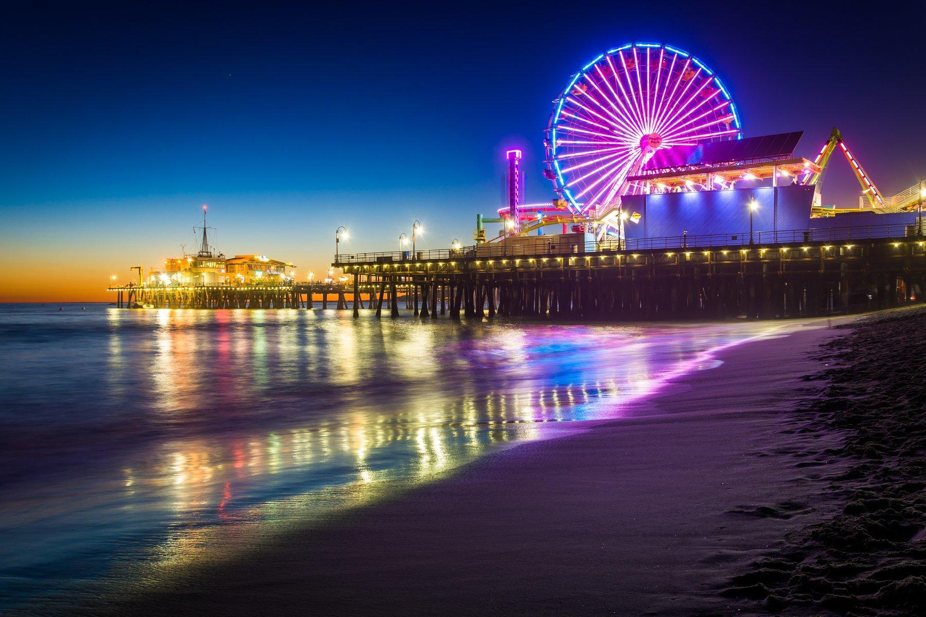 Santa Monica Pier lit up at dusk