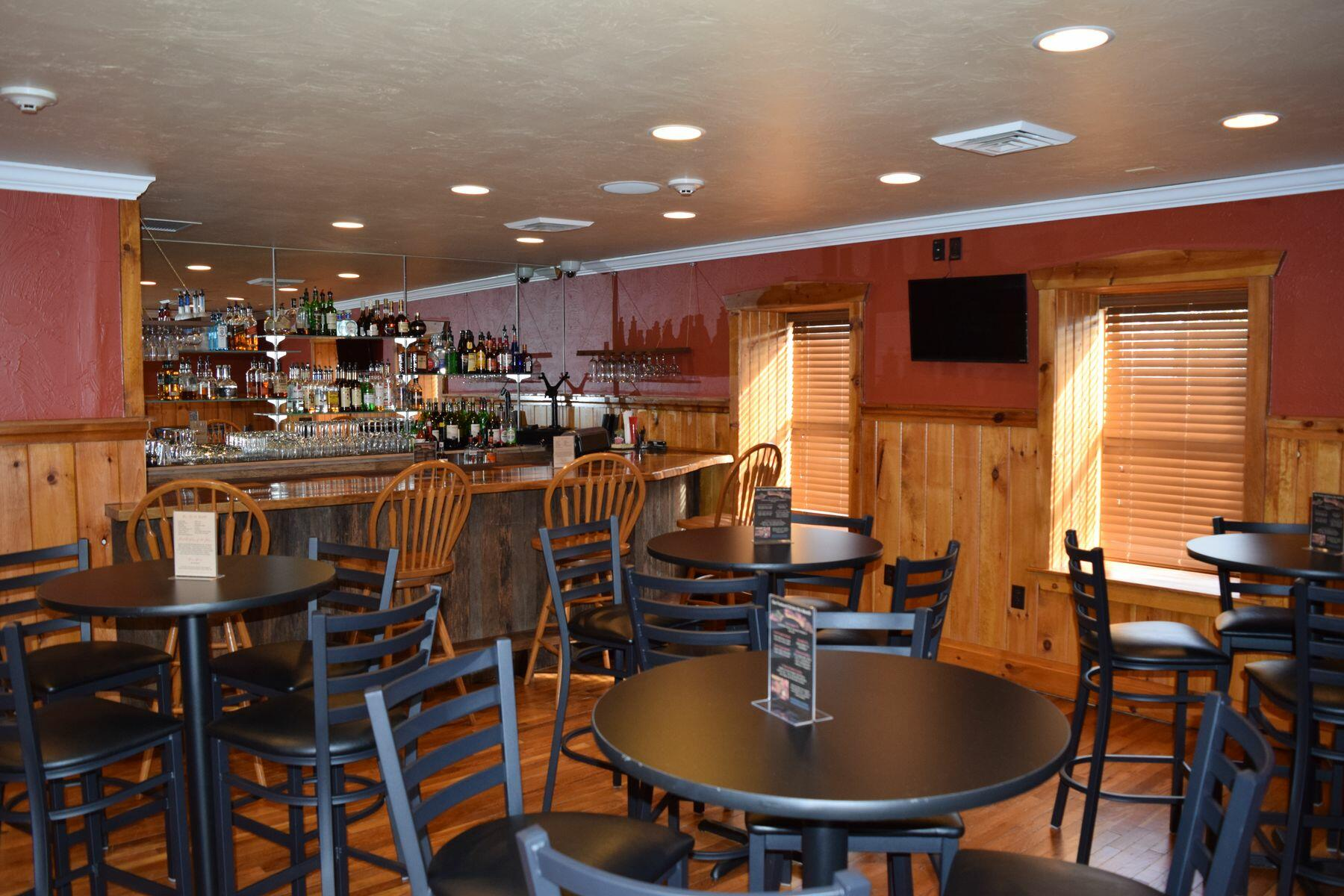 Bar and table seating in Gloryridge Tavern.