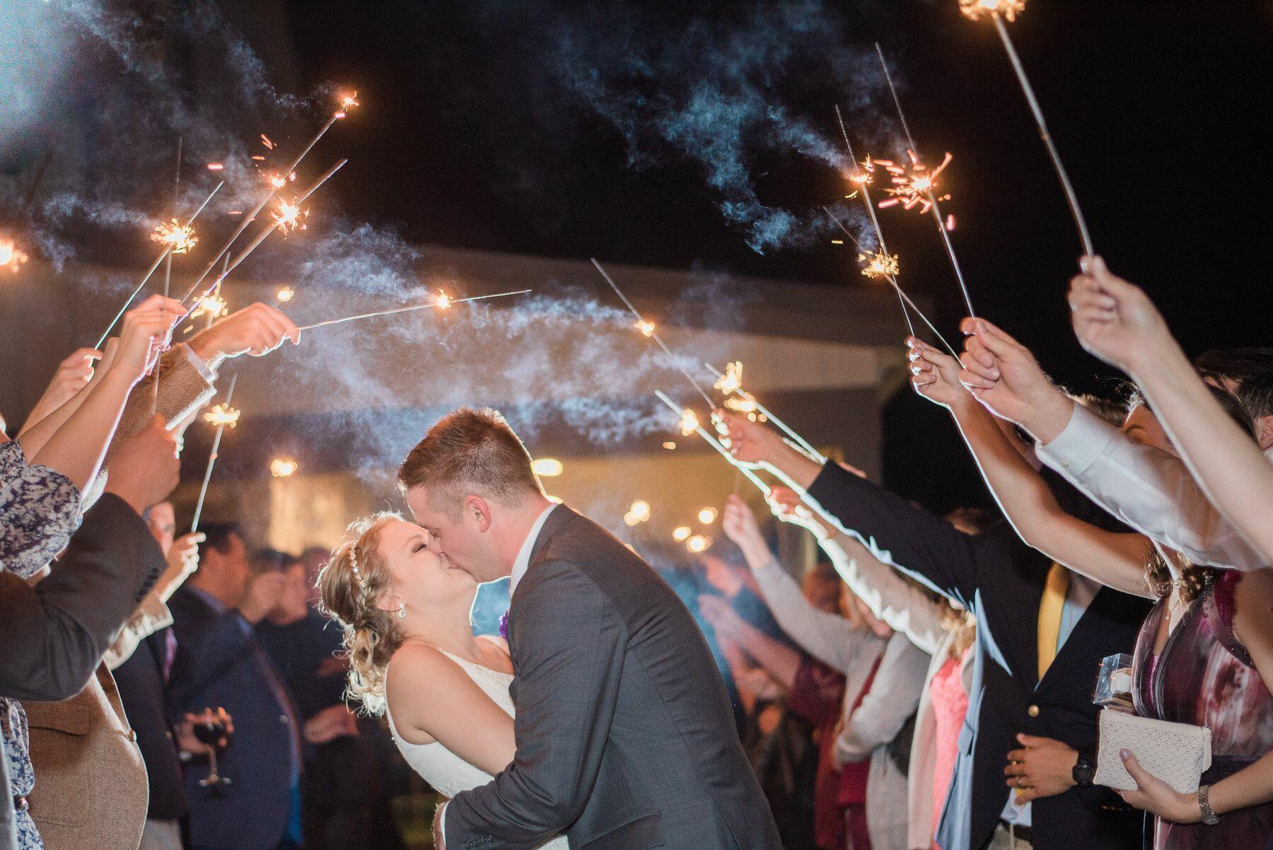 Newlyweds under sparklers.