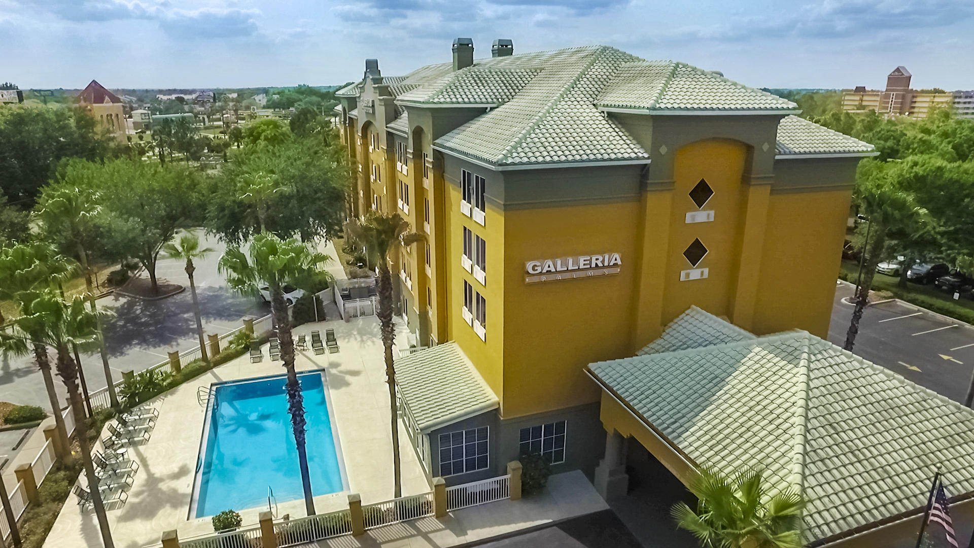 Aerial view of hotel and outdoor pool.