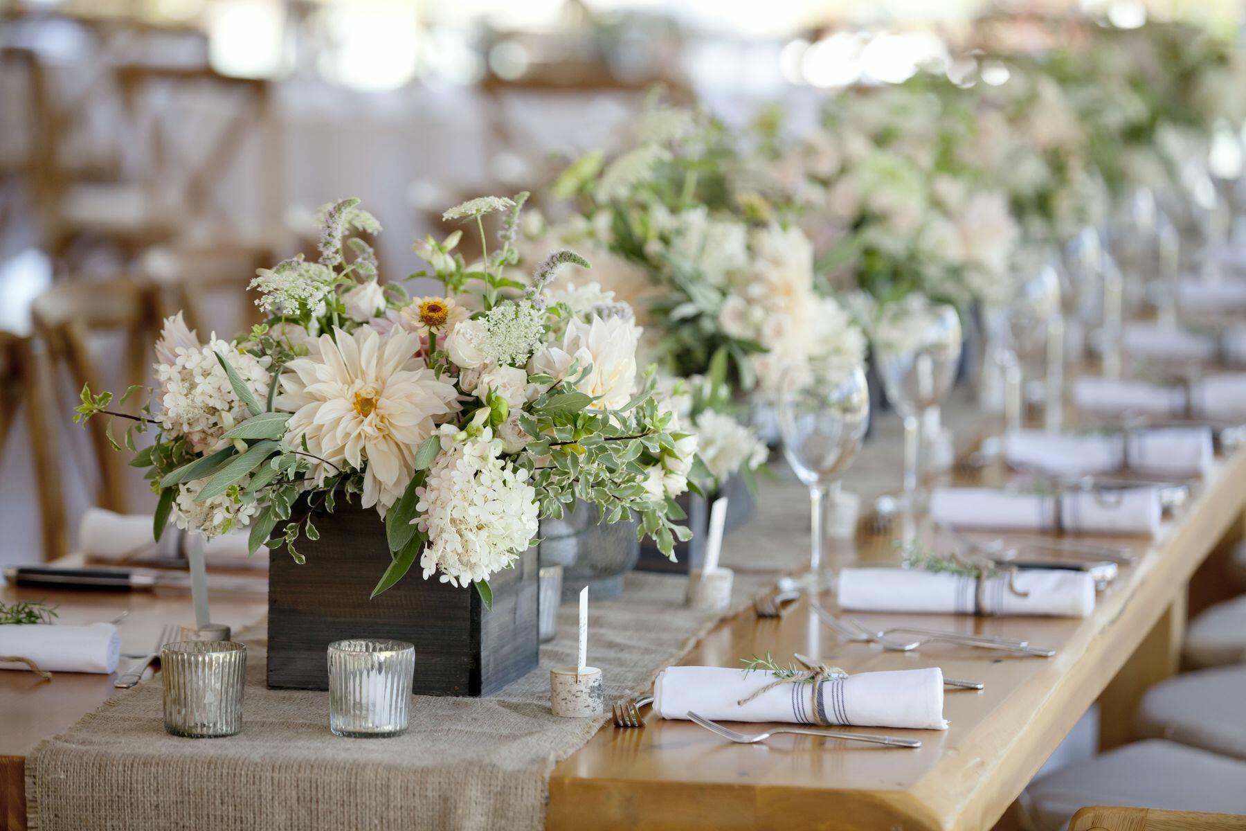 Banquet tables set for wedding reception.
