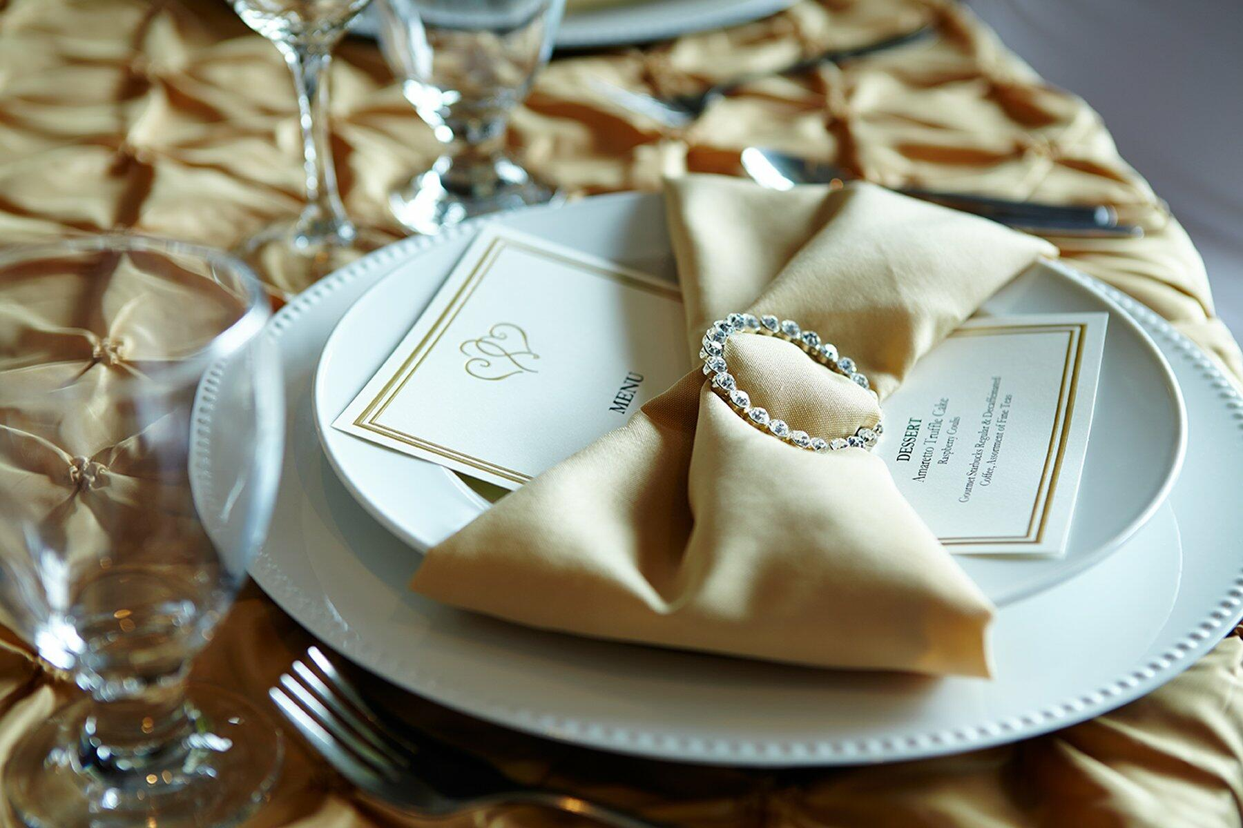 Place setting for wedding reception.
