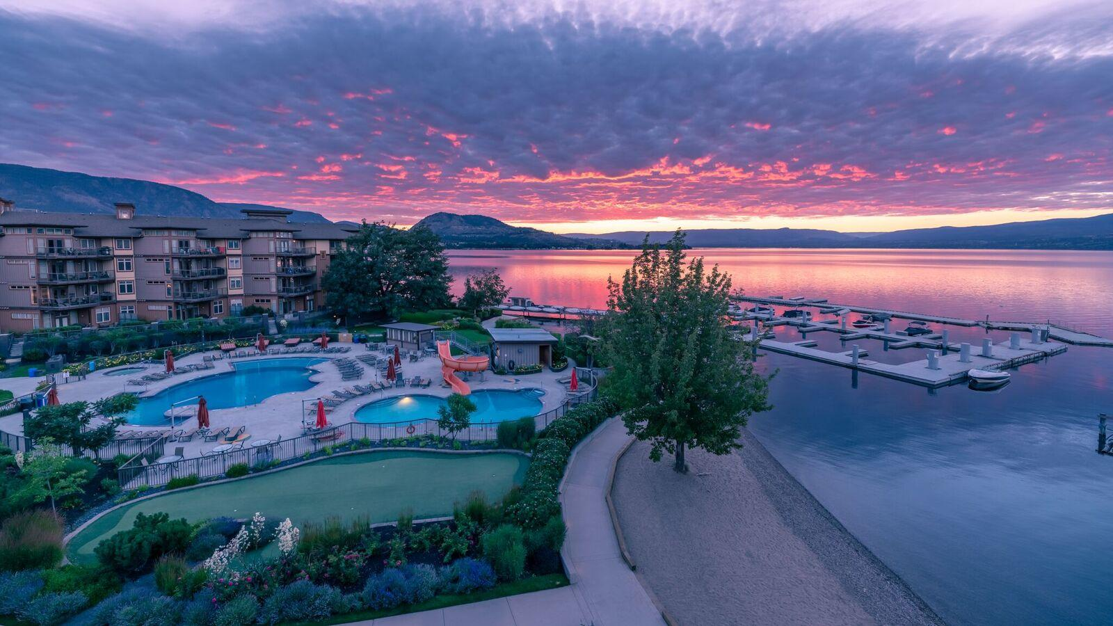 Aerial view of Cove Resort and Kelowna Lakefront at sunset