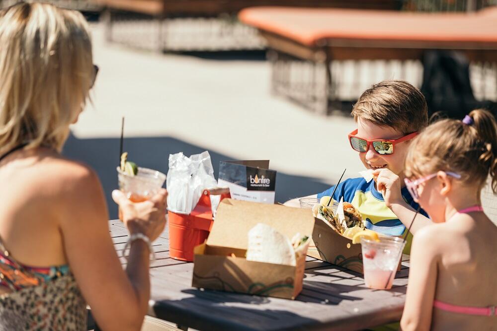 Family eating poolside