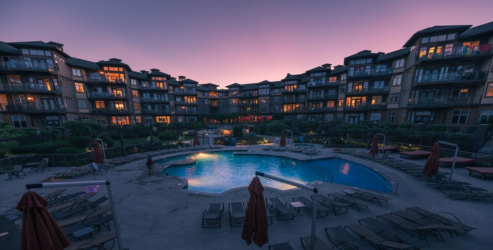 Exterior photo of inner cove and pool at sunset