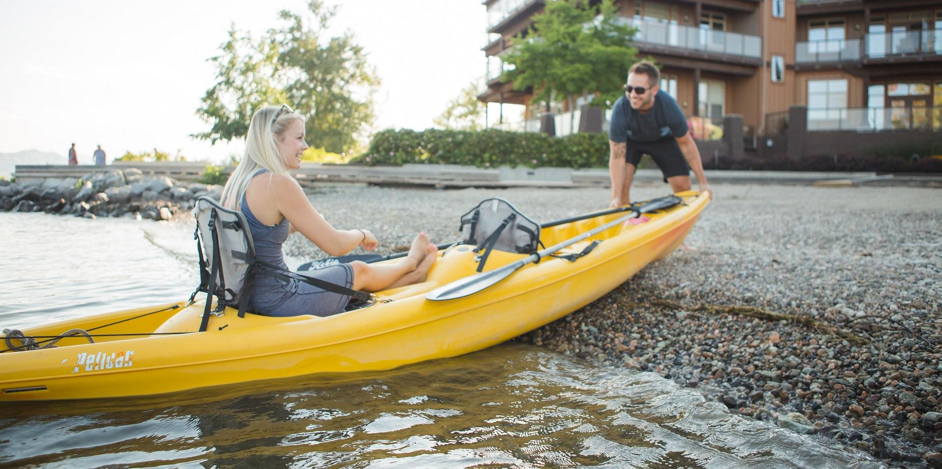 banner kayaking couple at the cove okanagan lake