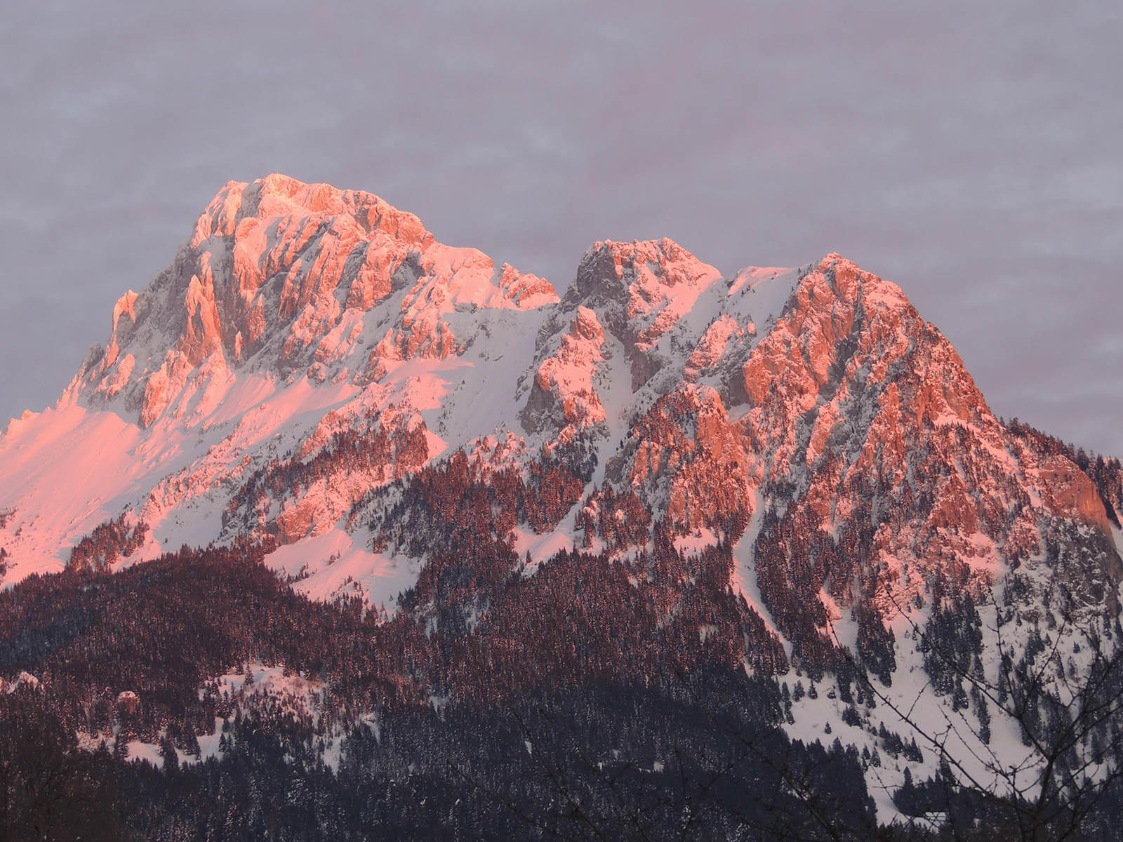 Sunset Light Reflected on Snowy Mountains near Hotel Les Gentian