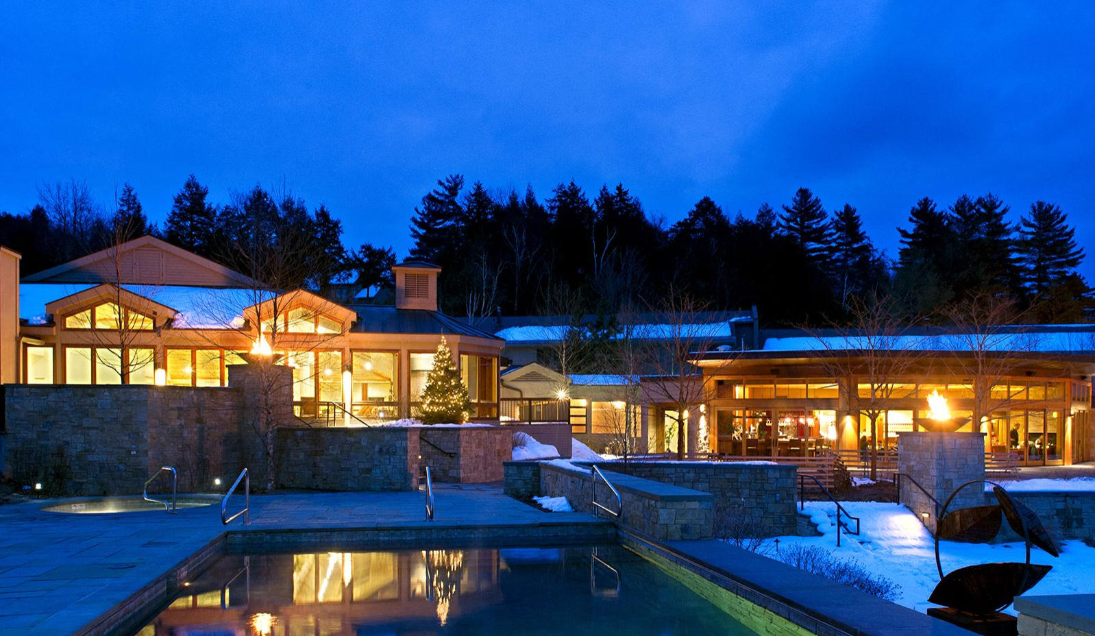 Topnotch Resort exterior on a wintry night.