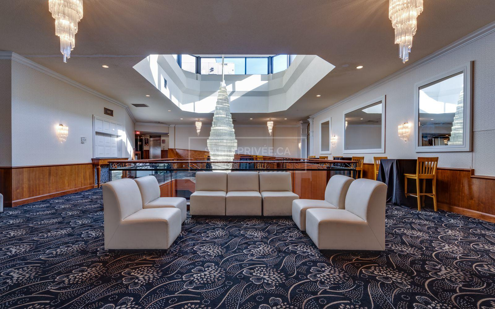 Couch and chairs in atrium.