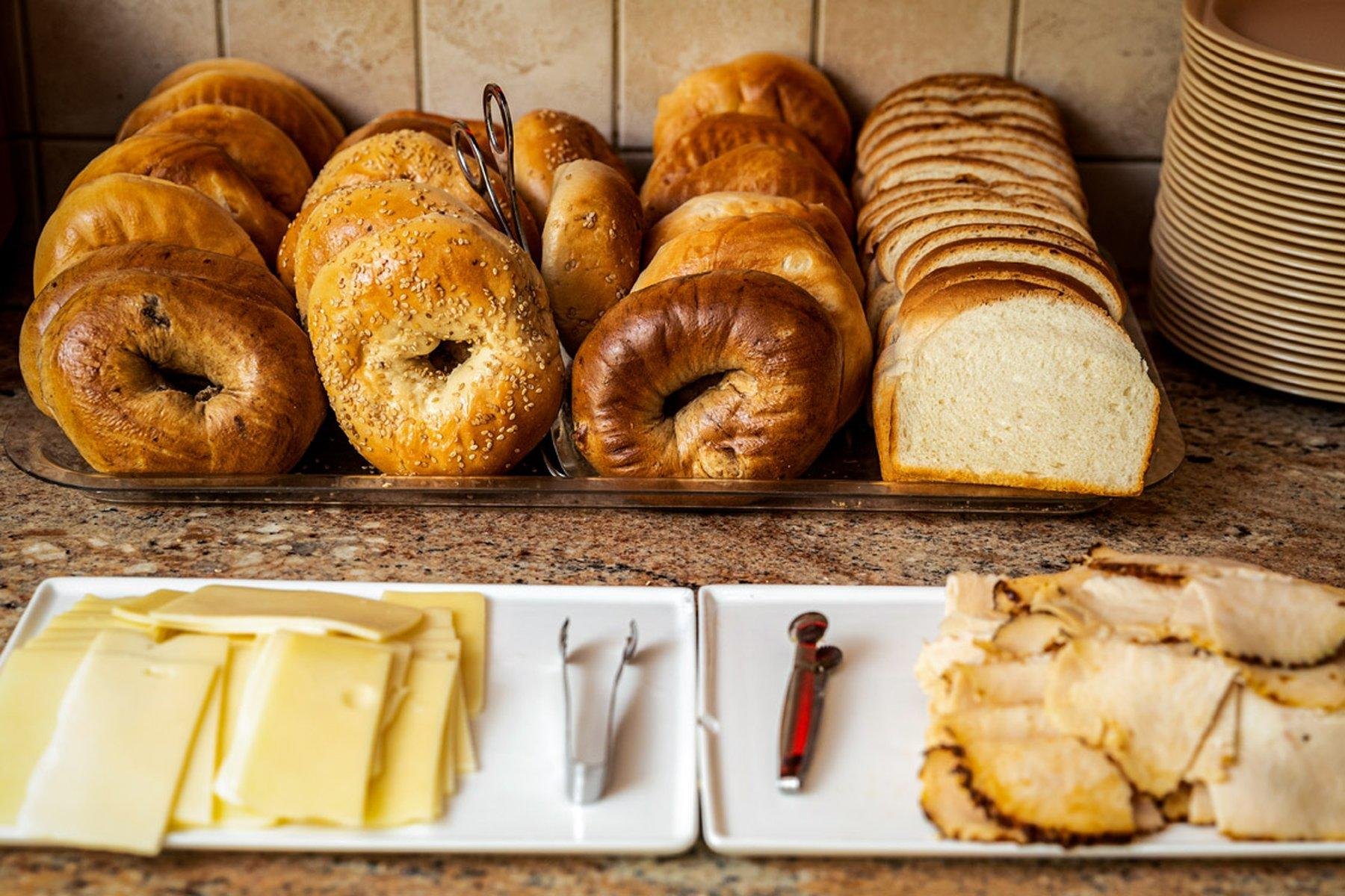 Assortment of bagels and cheese.