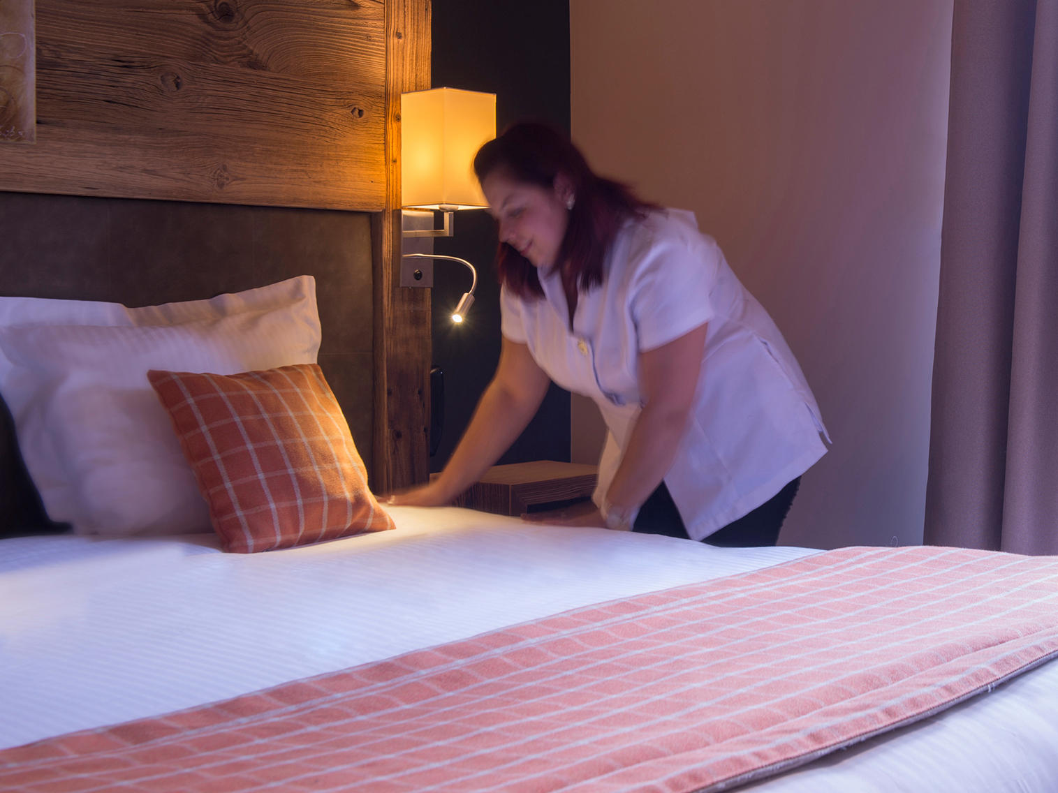 House Keeping Service Making Bed at Hotel Les Gentianettes, The