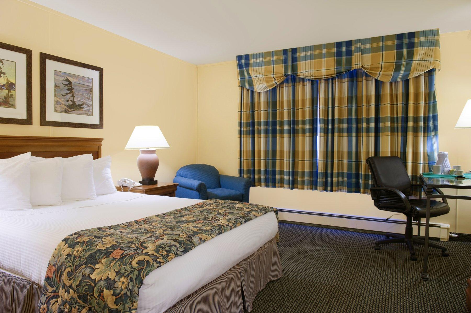 Hotel room with queen bed.