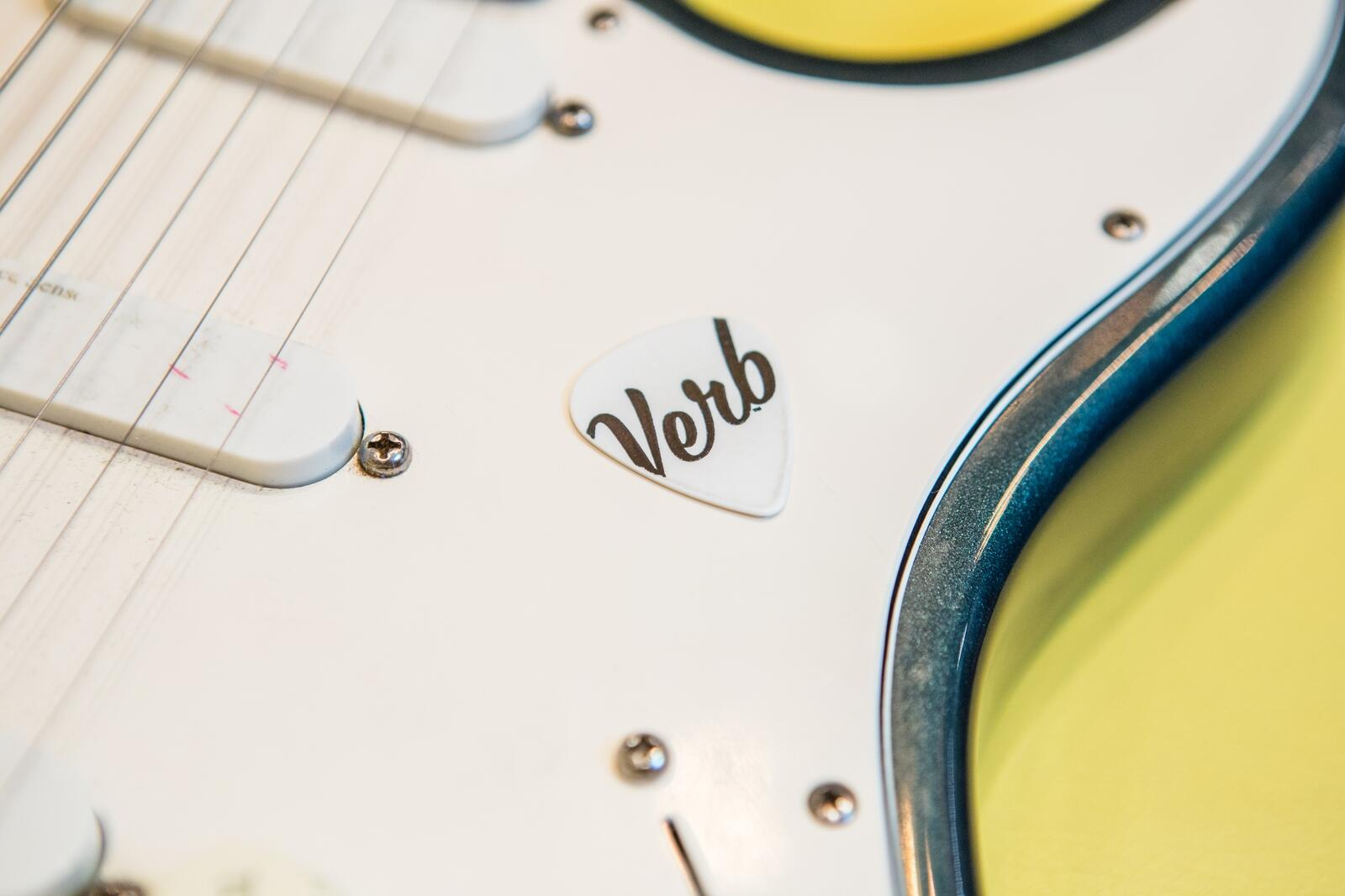 Guitar body detail shot with Verb branded guitar pick