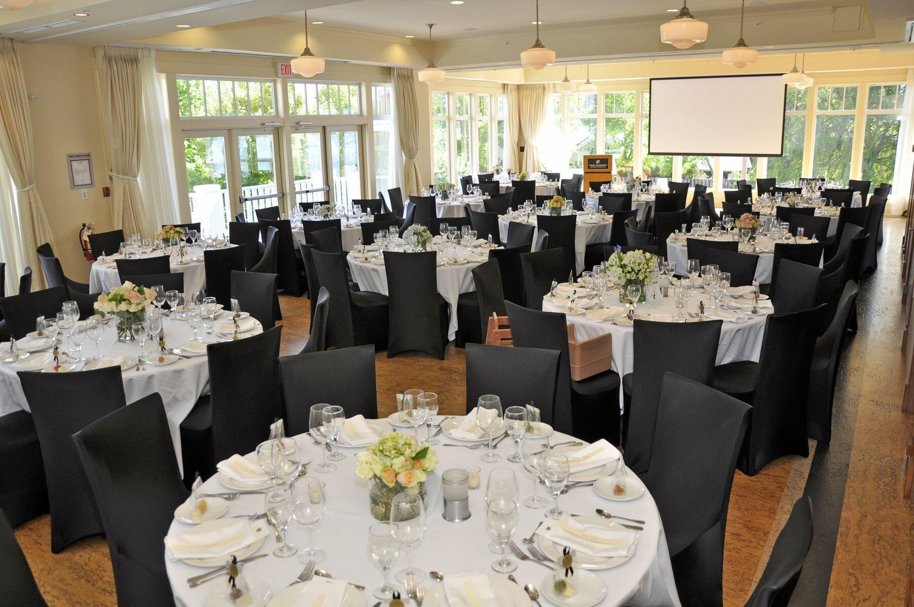 Ballroom with lake view set for wedding reception.