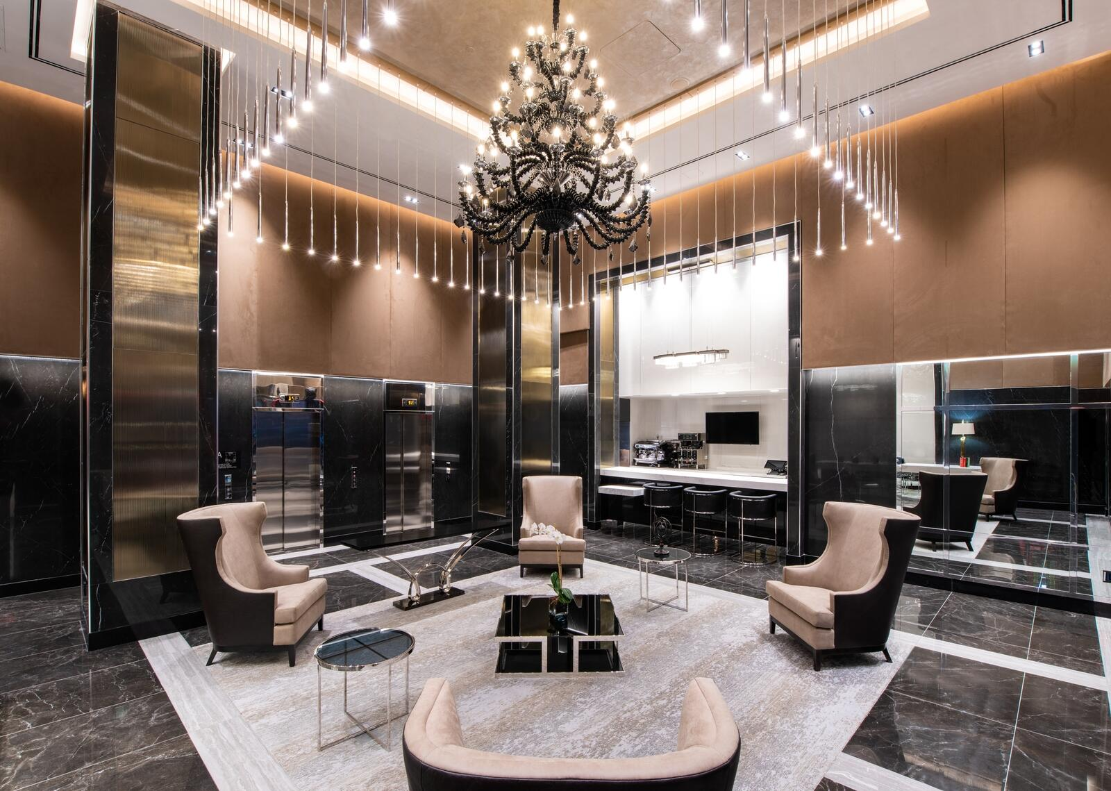 reception area of hotel with chairs and chandeliers