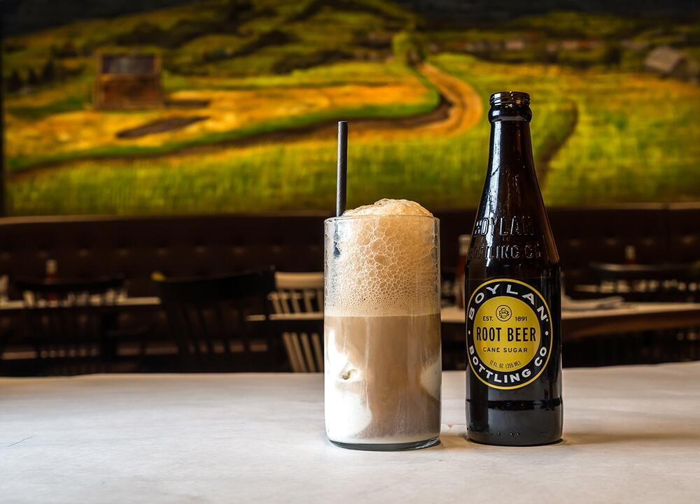 root beer bottle and root beer in a mug
