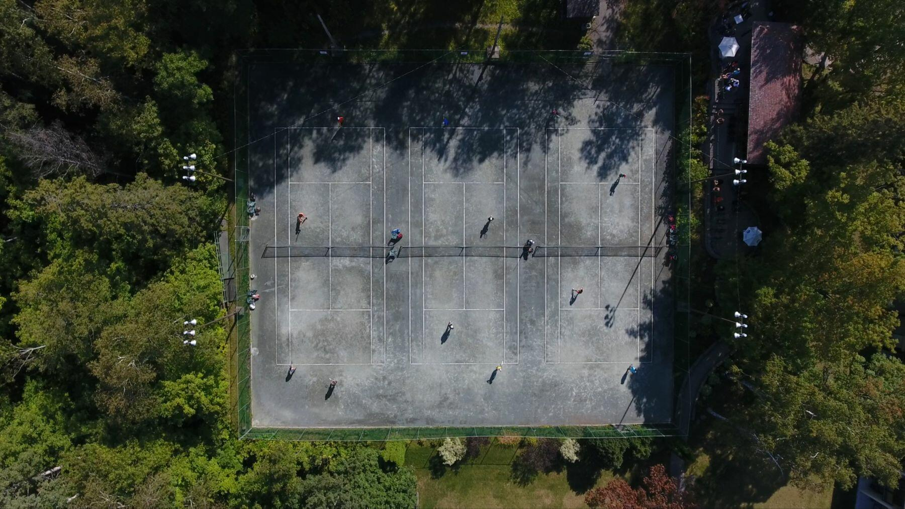 Ariel view of multiple tennis courts