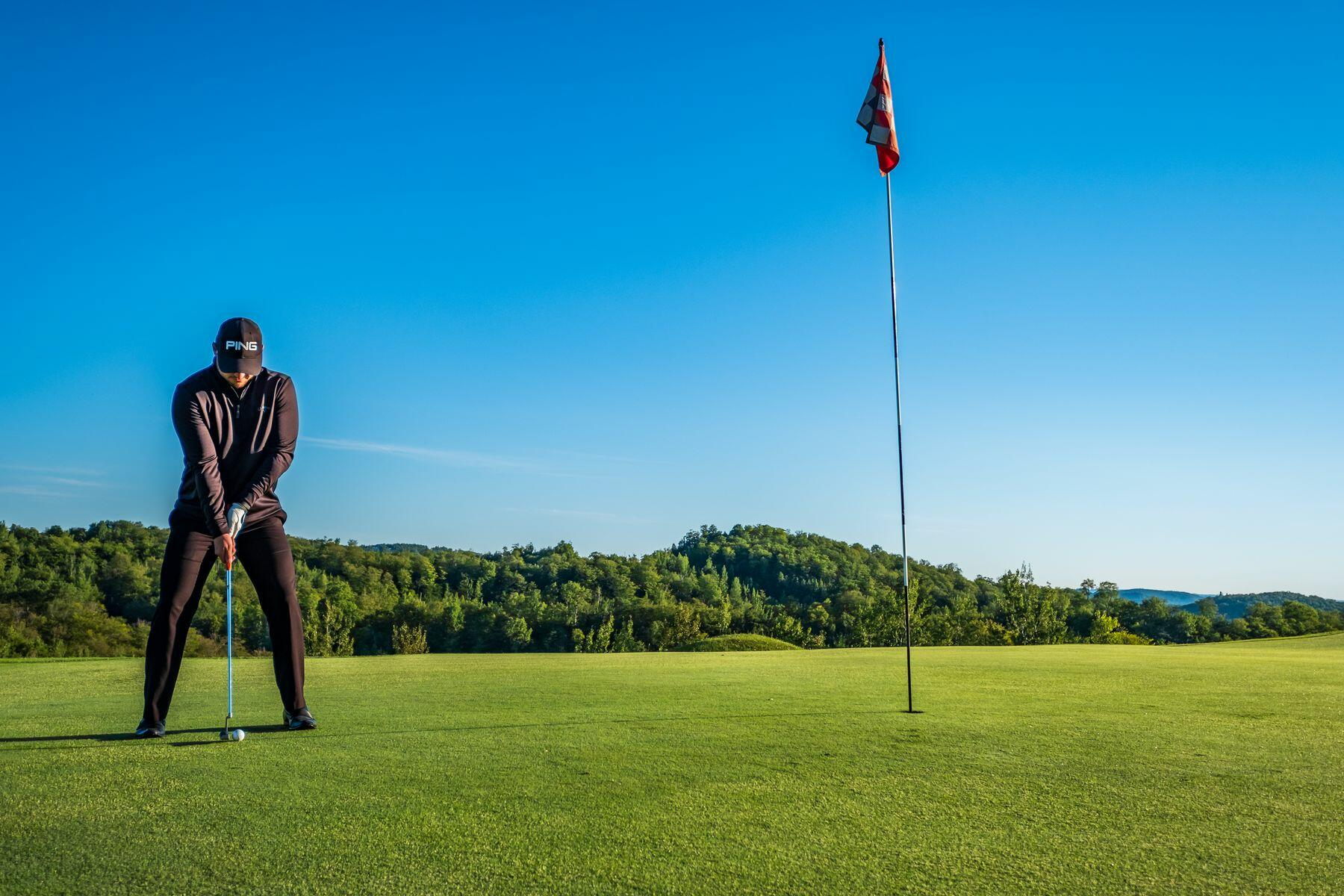 A Man on a putting green