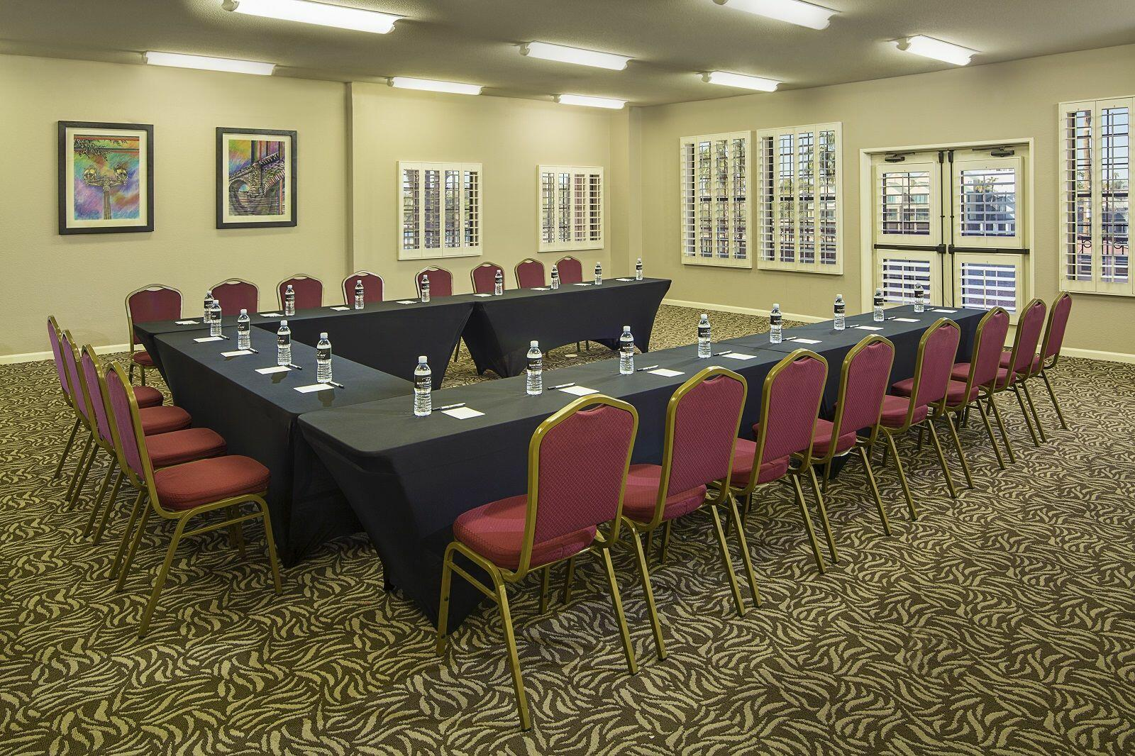 Meeting room with U-shaped conference table.