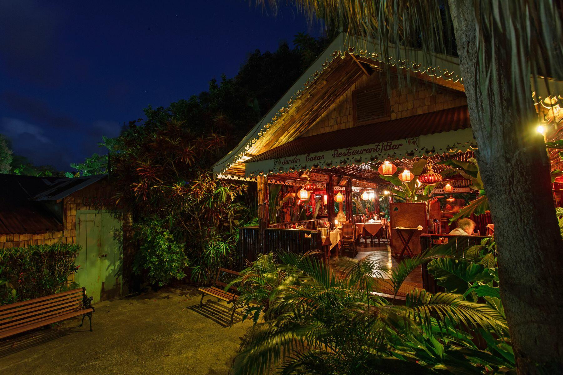 hut in tropical setting at night