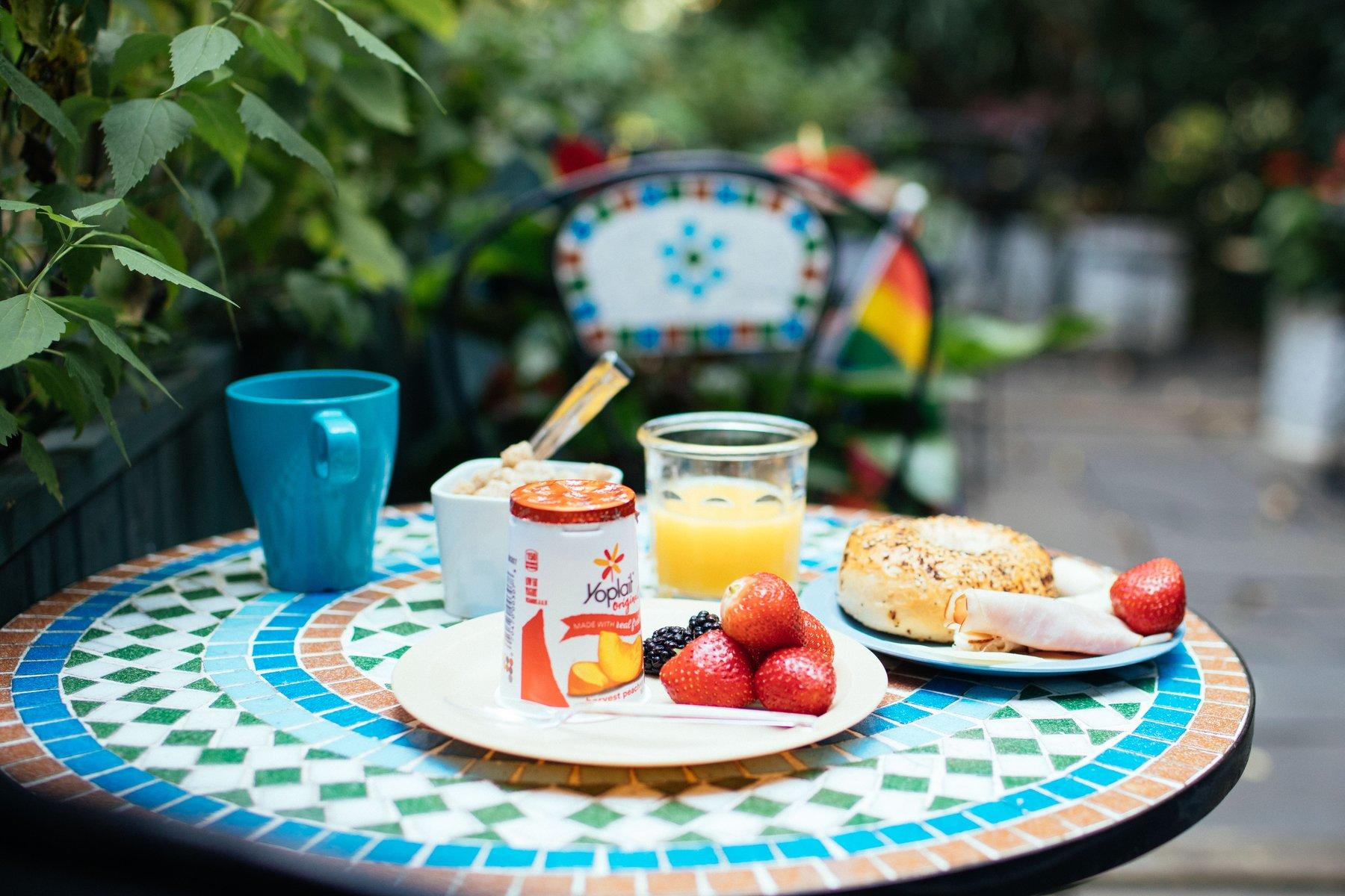 Outdoor bistro table with fresh breakfast.