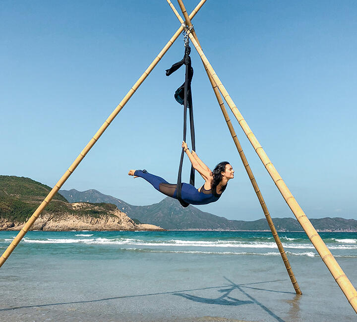 Bamboo Yoga Retreat - lady performing aerial yoga