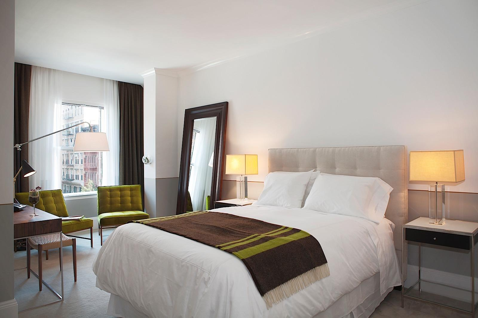 Junior Suite Interior with queen bed and city views