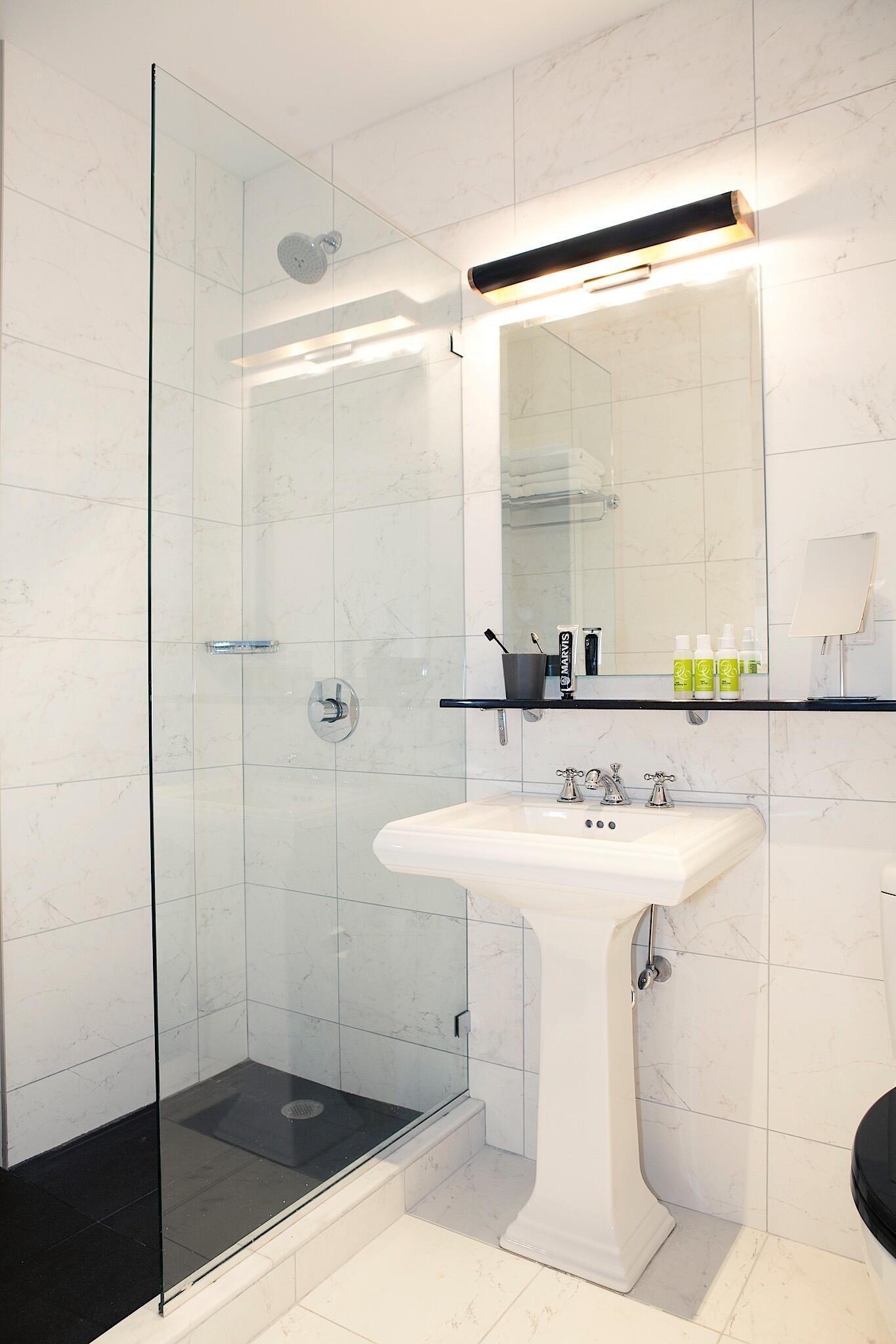 Suite Bathroom Interior with pedestal sink