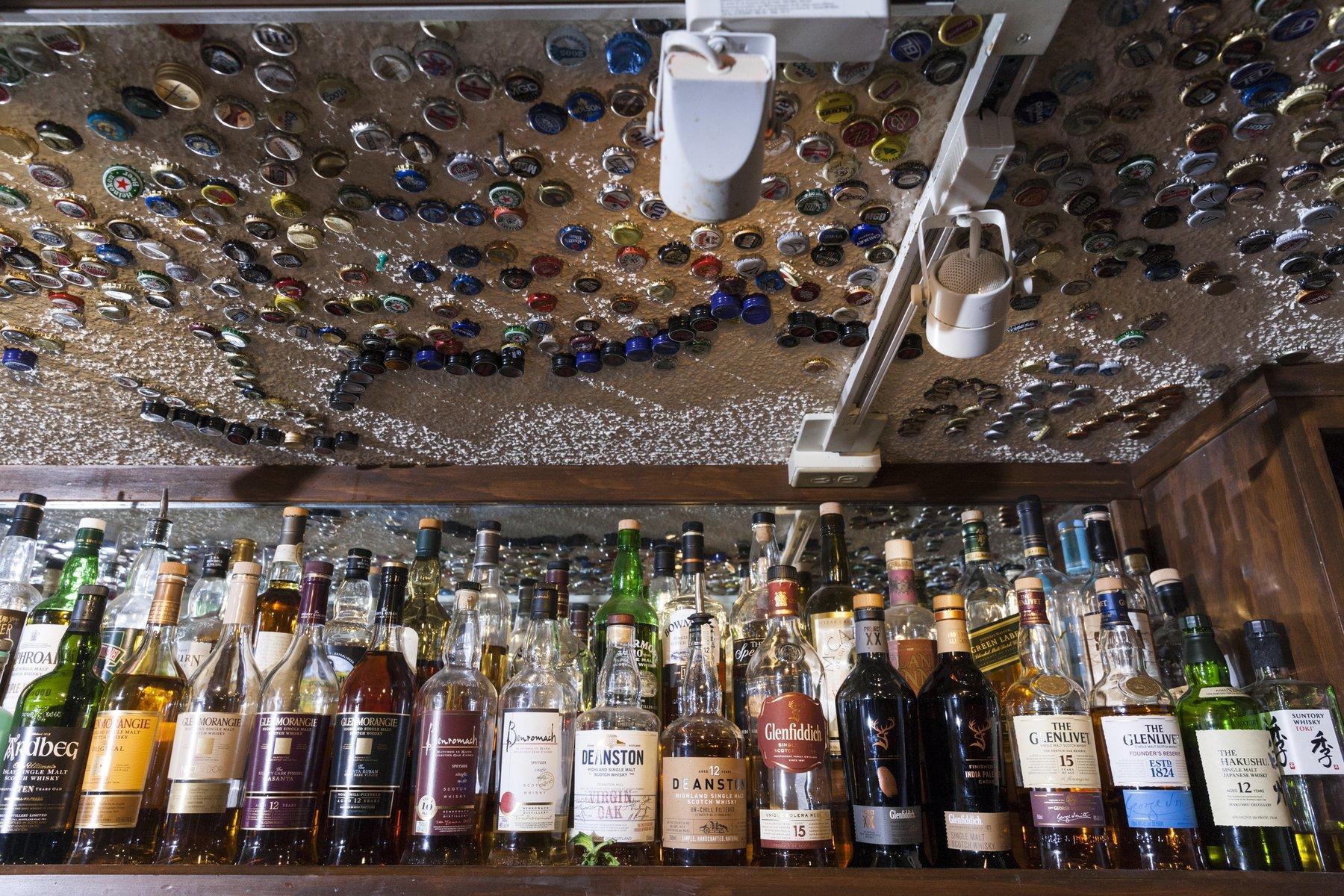 shelf lined with liquor bottles