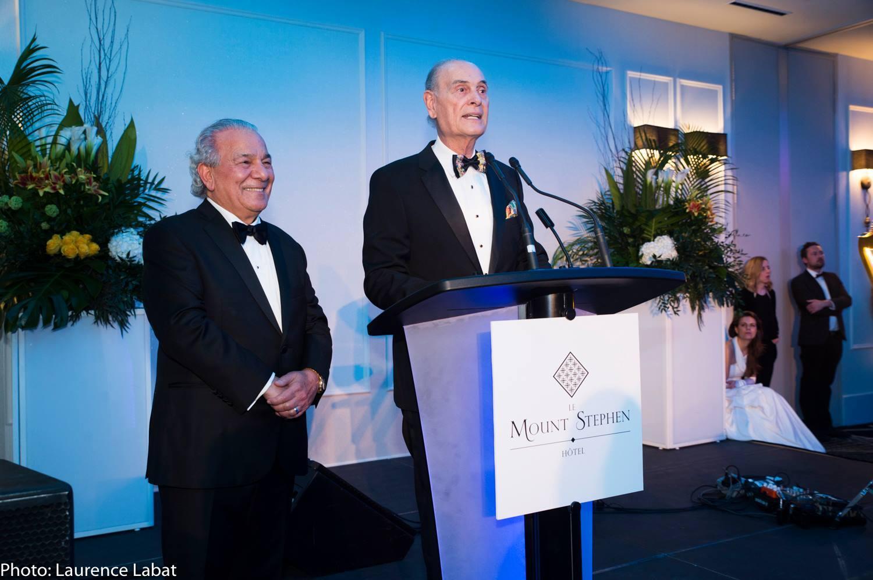 Two men speaking at a podium