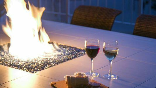 A glass of both red and white wine on an outside table