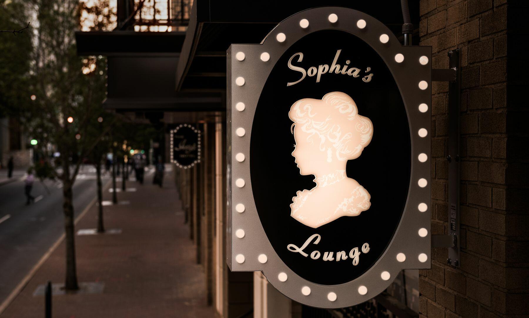 outside sign for sophias lounge