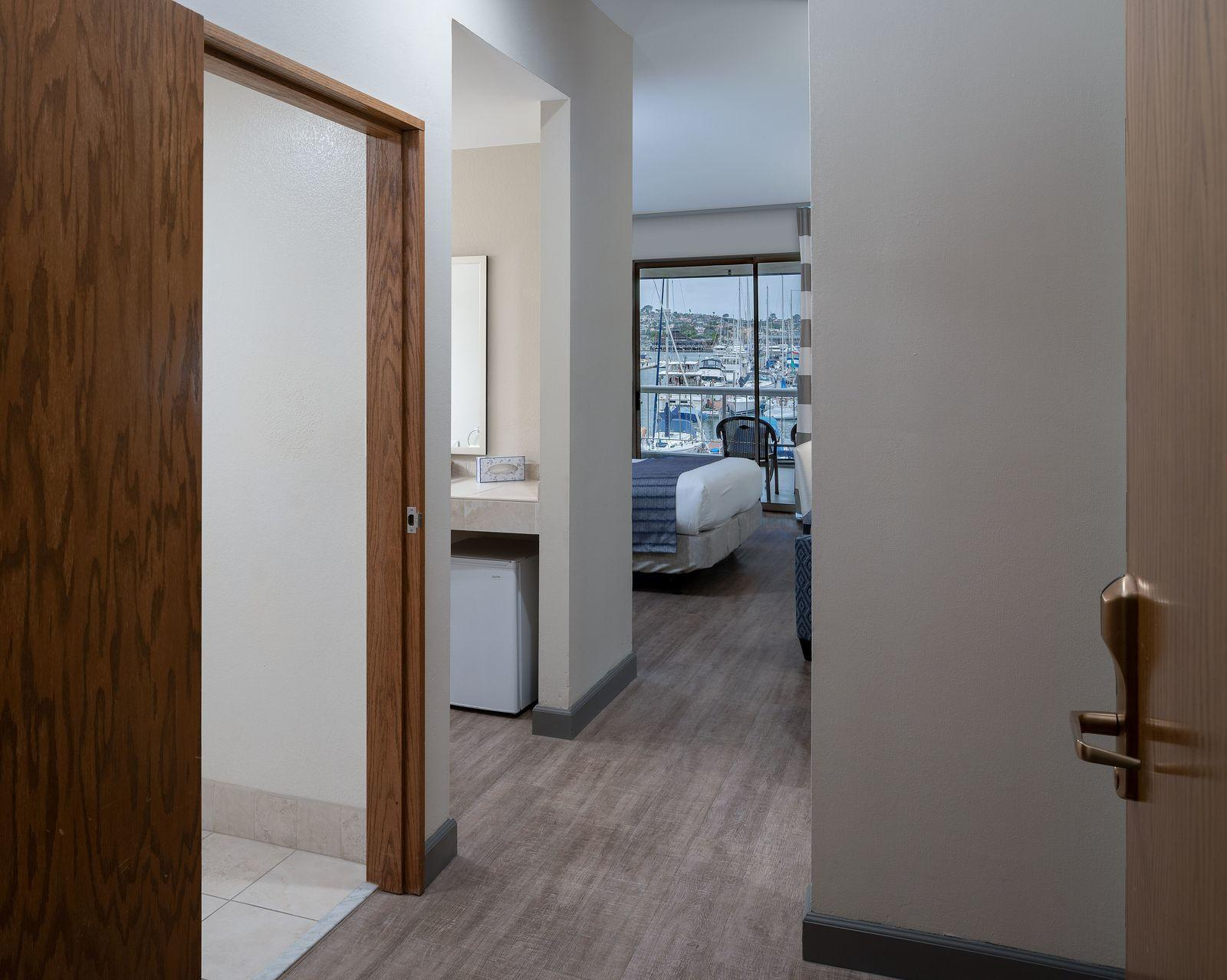 An accessible room with a king bed and a marina view