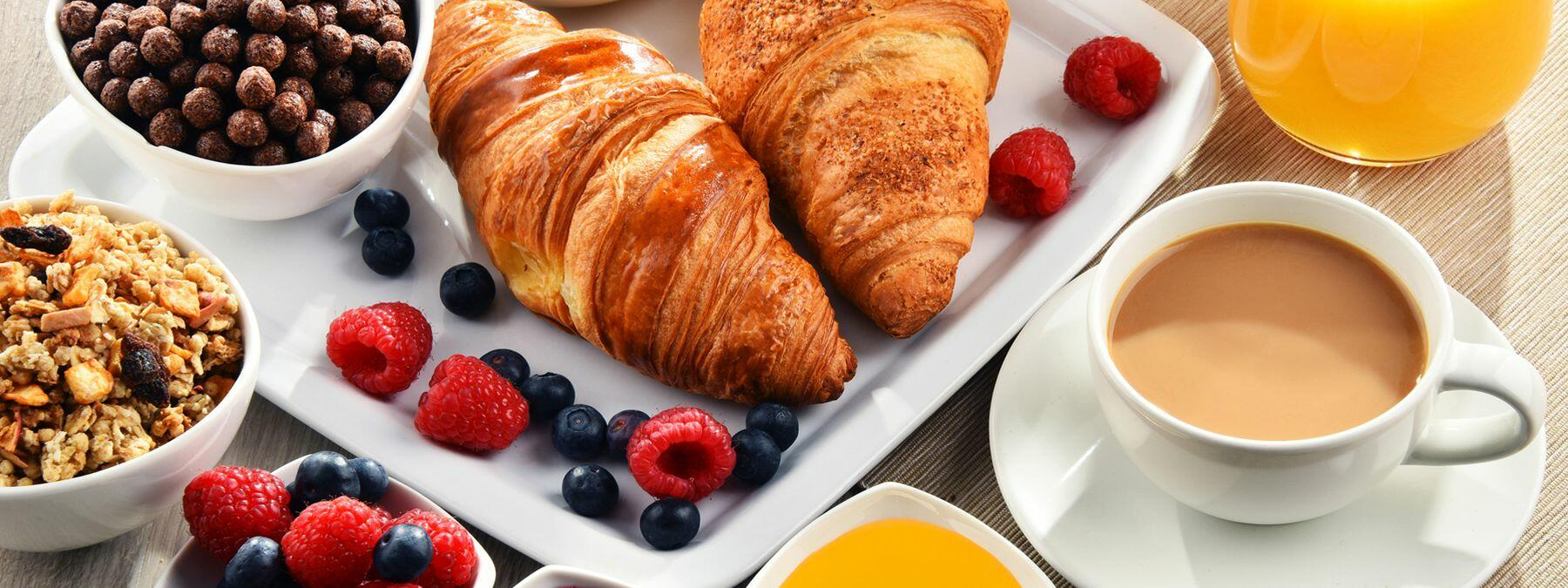 breakfast display with croissants and fruit