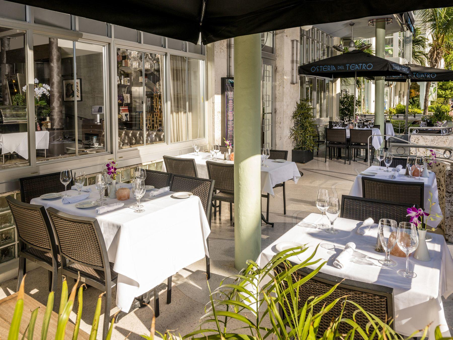outside restaurant and tables with white table cloths