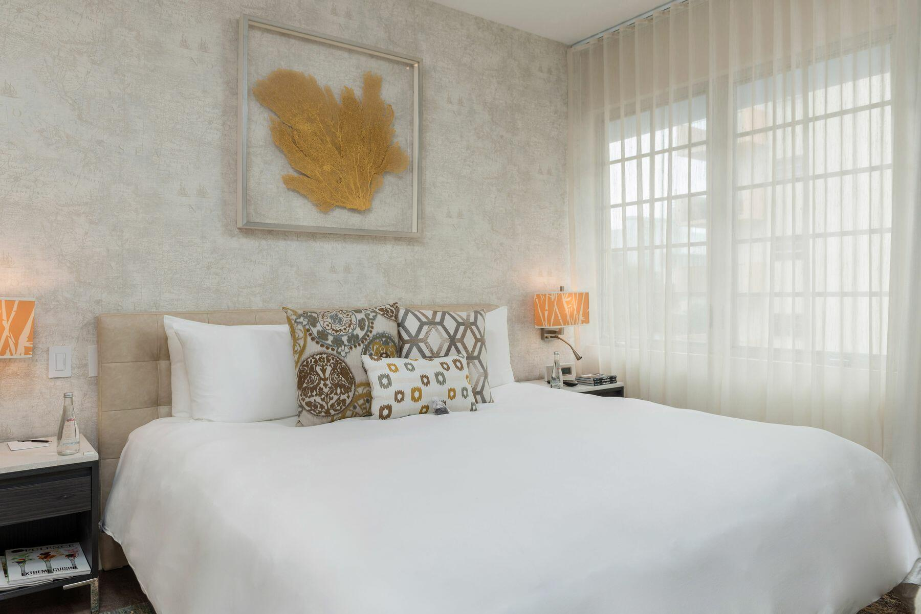 cozy bed with white sheets