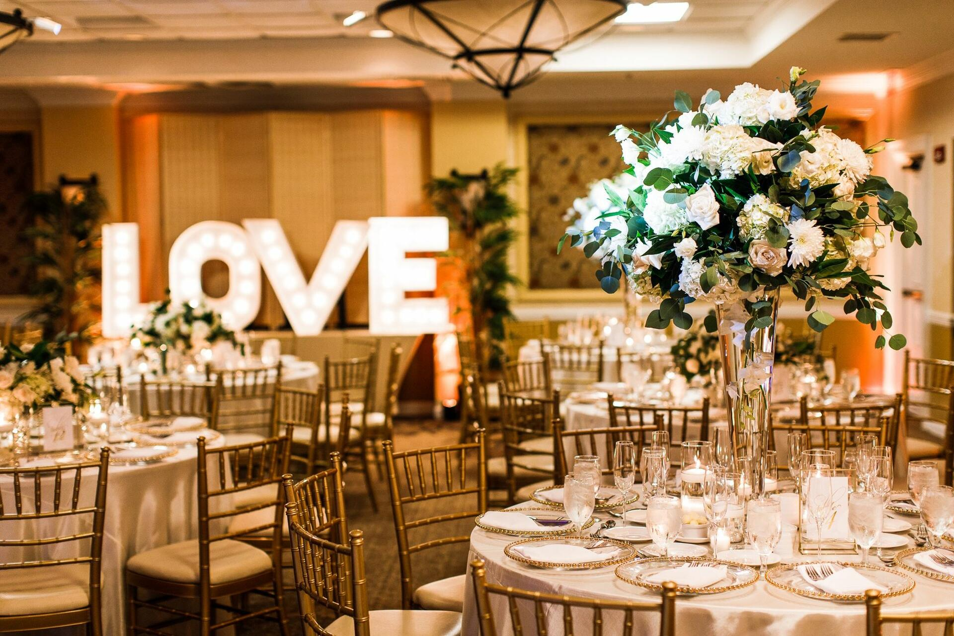 wedding decorations with flowers and sign that says l-o-v-e