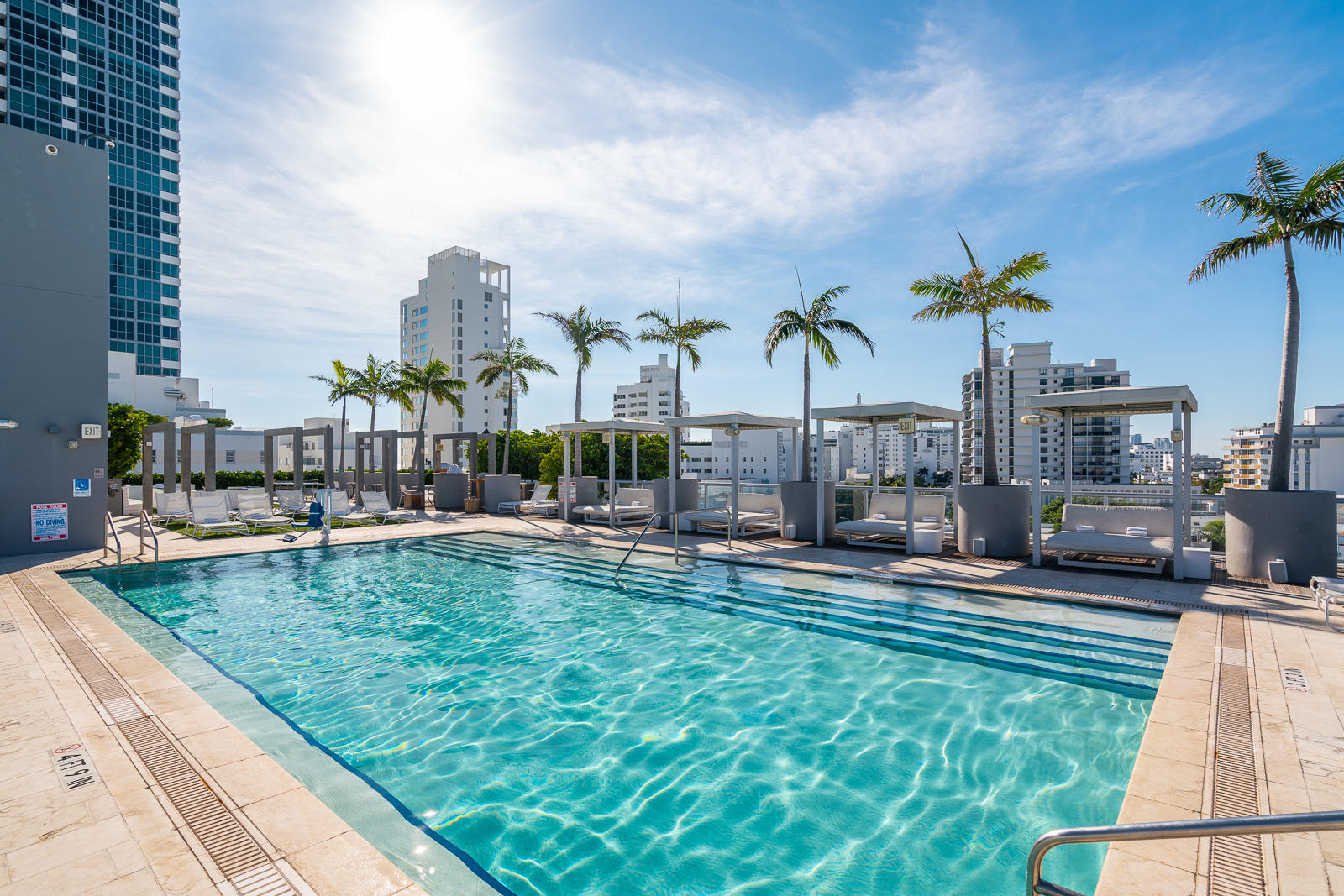 cabanas and lounge chairs at rooftop pool
