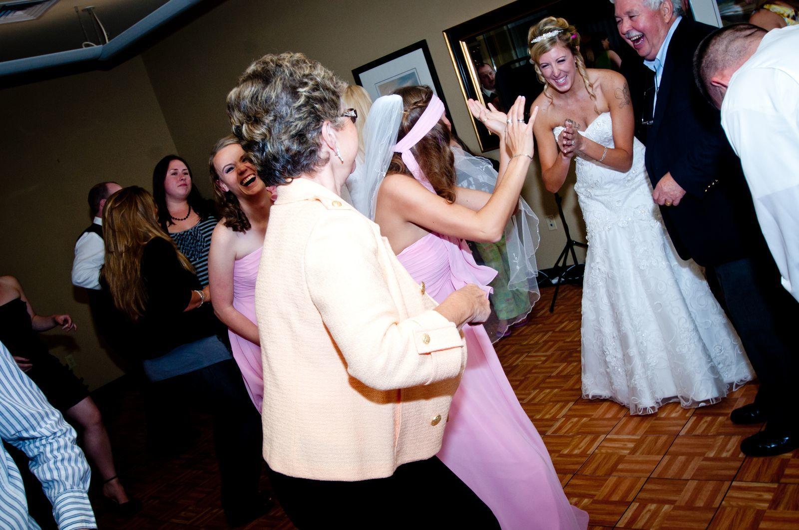 Family dancing at wedding reception.
