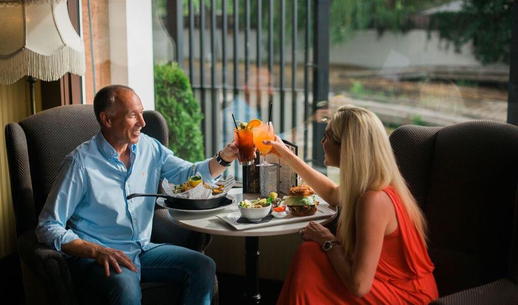 Happy couple enjoying mimosas.