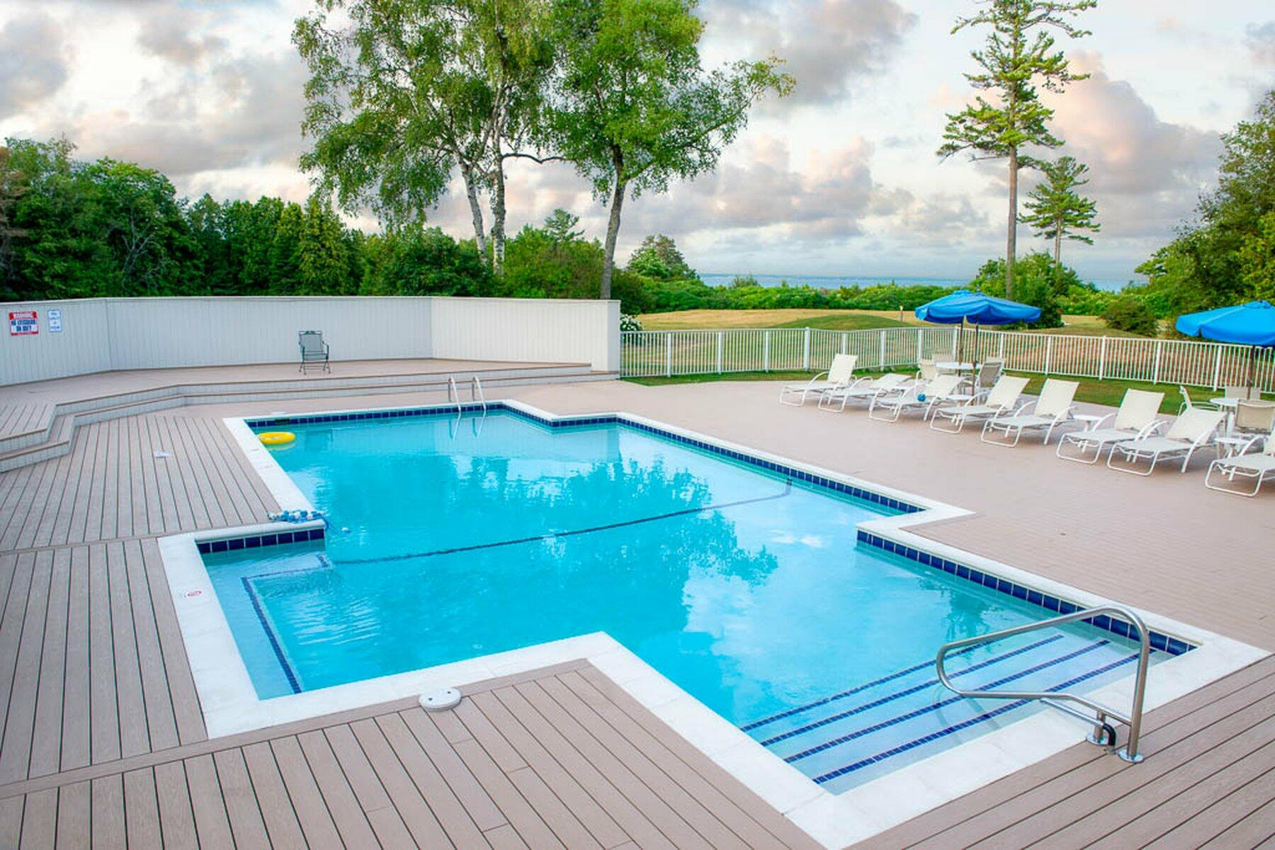 outdoor pool with lounge chairs