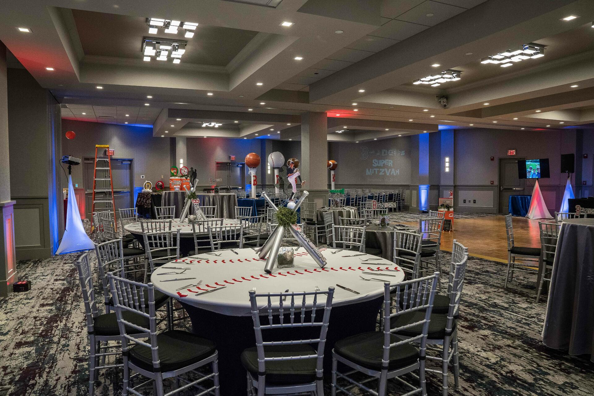 banquet room with baseball themed centerpieces on tables