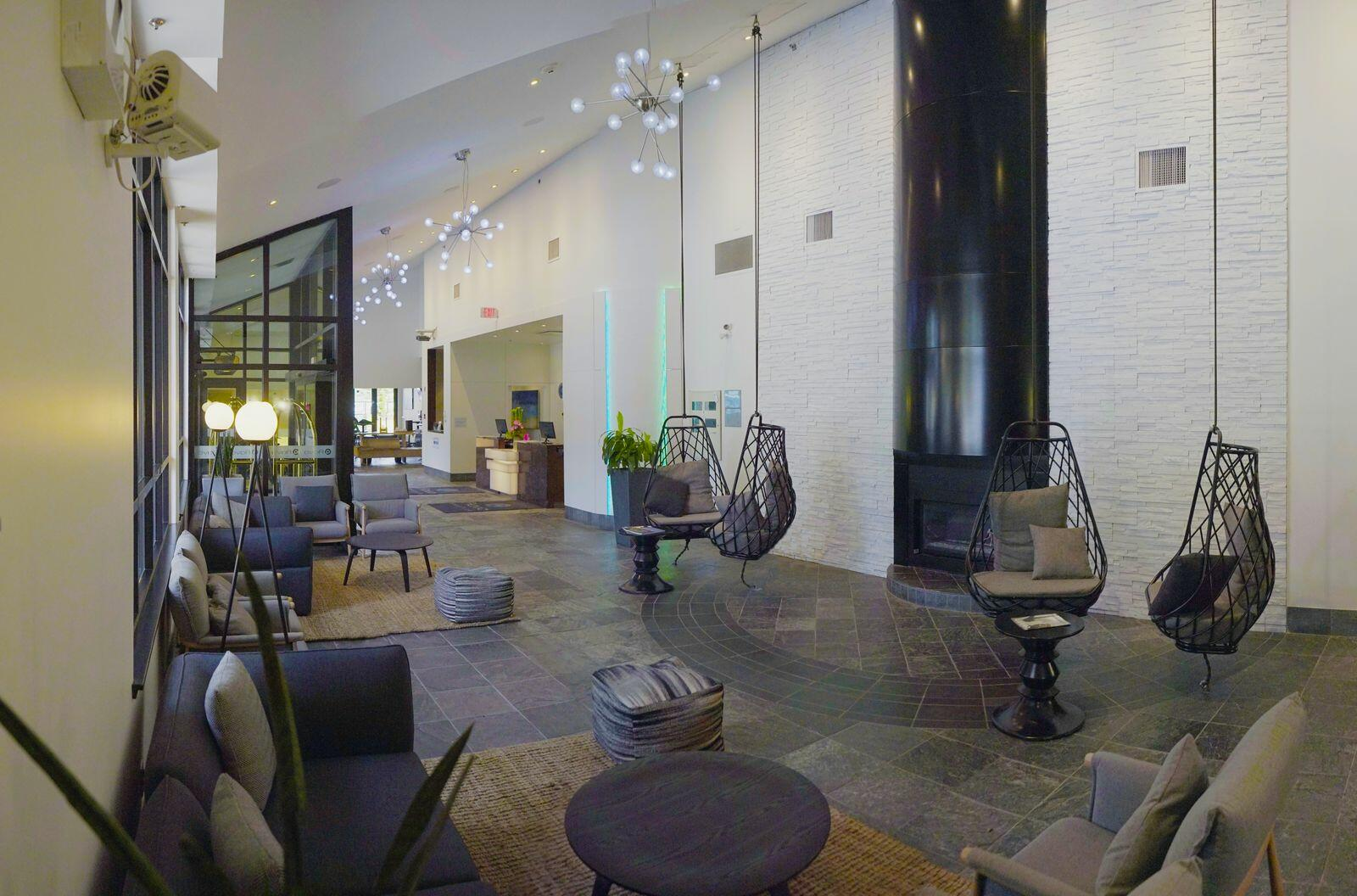 Hammock chairs hanging from ceiling in hotel lobby