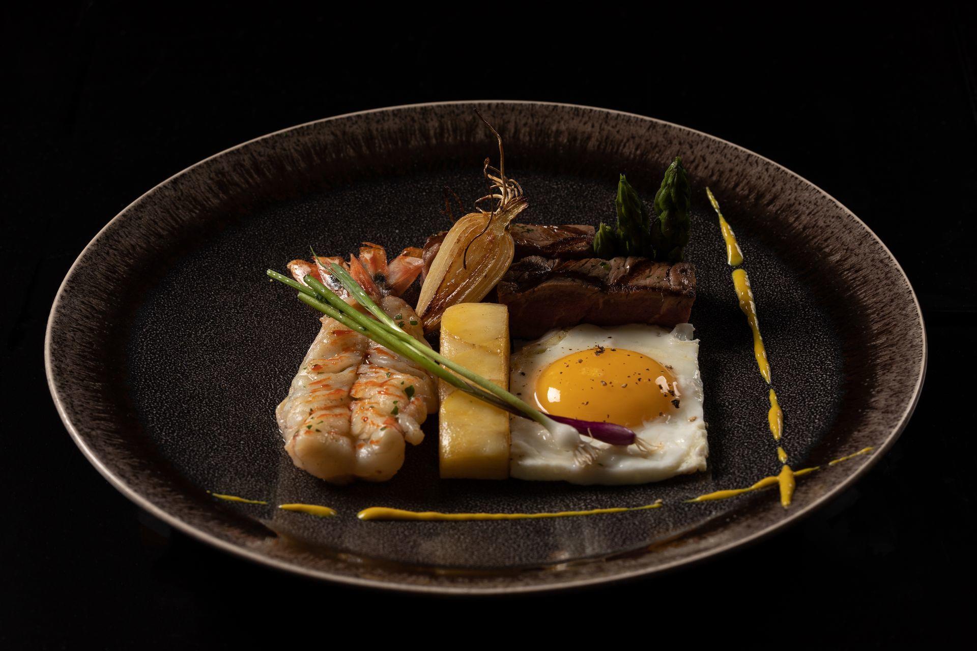 shrimp, steak, and egg dish