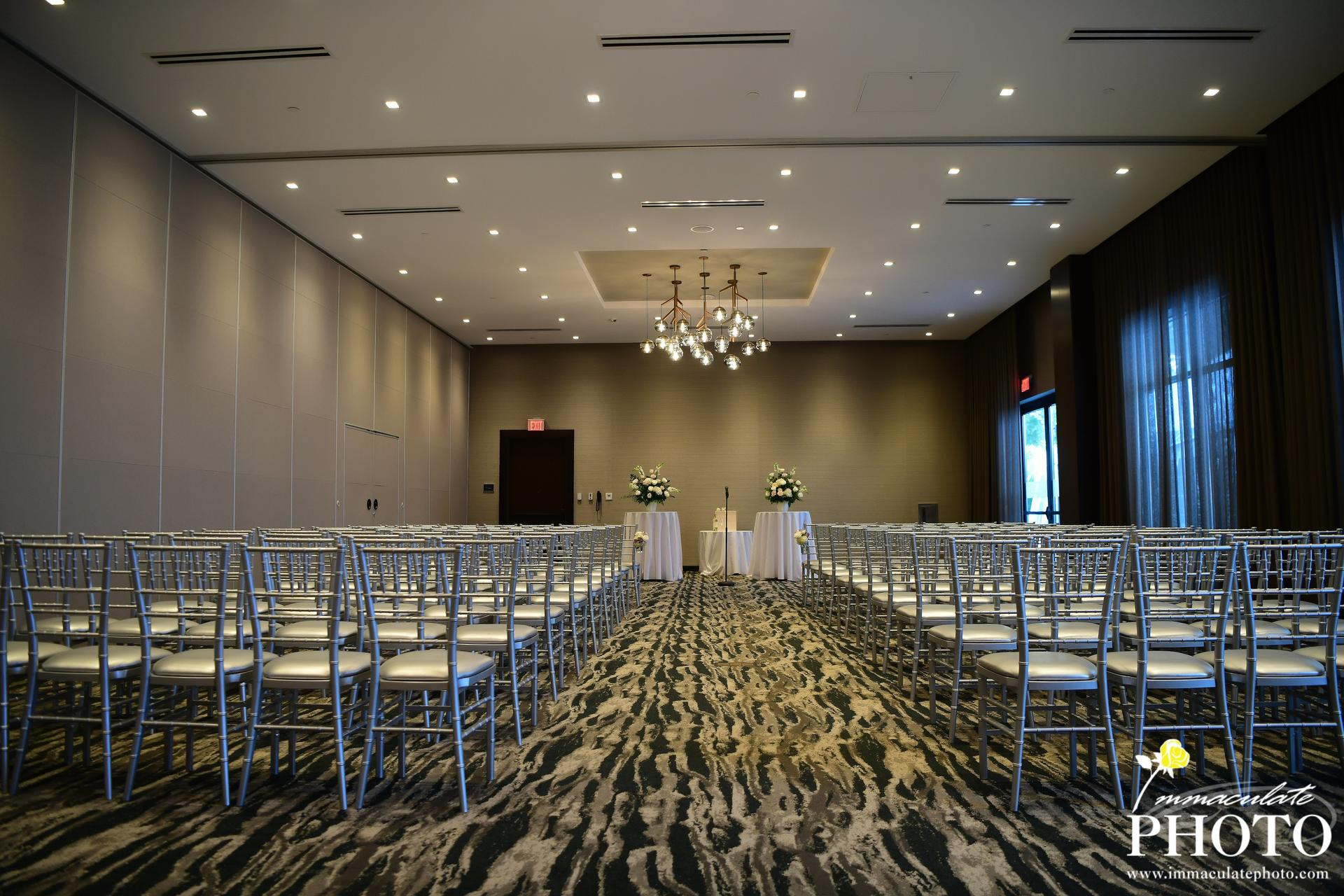 chairs set up for wedding in ballroom