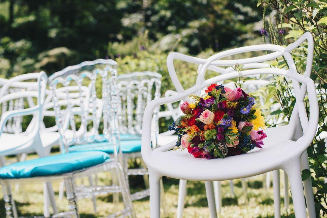 white chair with bouquet of flowers