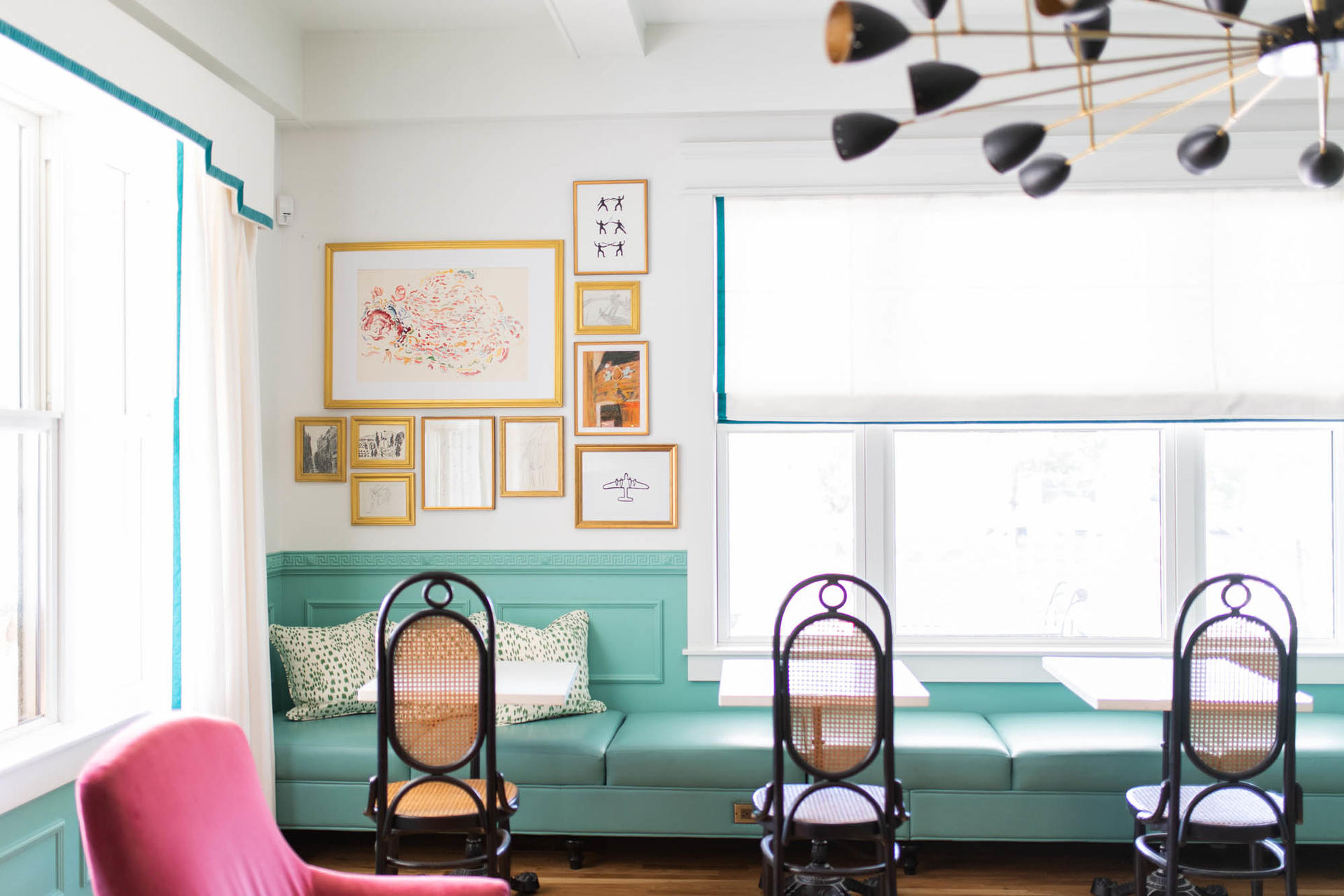 white room with blue seats and pink chair
