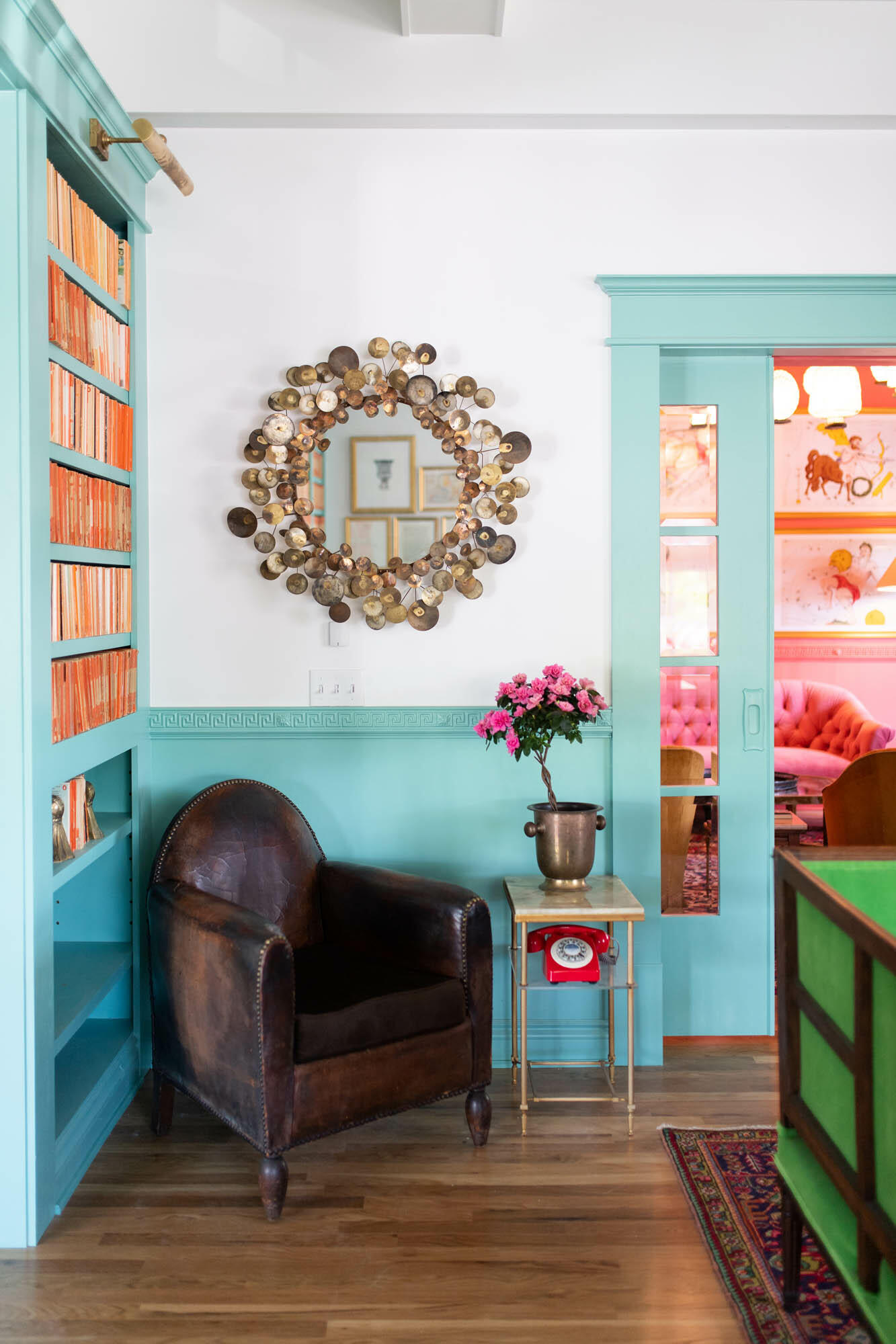 lounge area with leather chair and blue book shelf